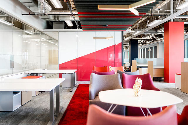 open office space with red accents by Office Environments