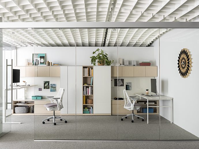 Shared private office with height-adjustable tables and task chairs