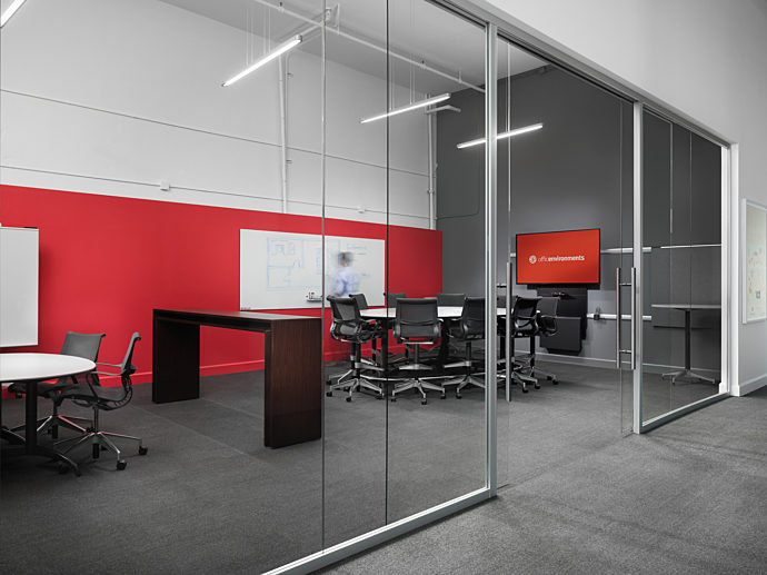 Standing height conference tables, setu stools, conference chairs, glassboards and media displays from Herman Miller