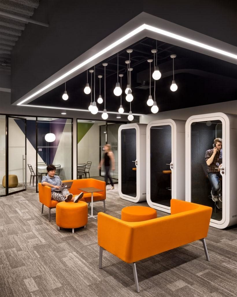 orange couches in working lounge area
